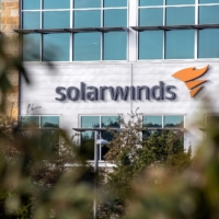 The SolarWinds logo is seen outside its headquarters in Austin, Texas, on Friday. | REUTERS
