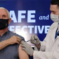 U.S. Vice President Mike Pence receives a COVID-19 vaccine at the White House in Washington on Friday. | REUTERS
