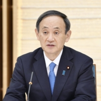 Prime Minister Yoshihide Suga speaks during a meeting in Tokyo on Friday. | KYODO