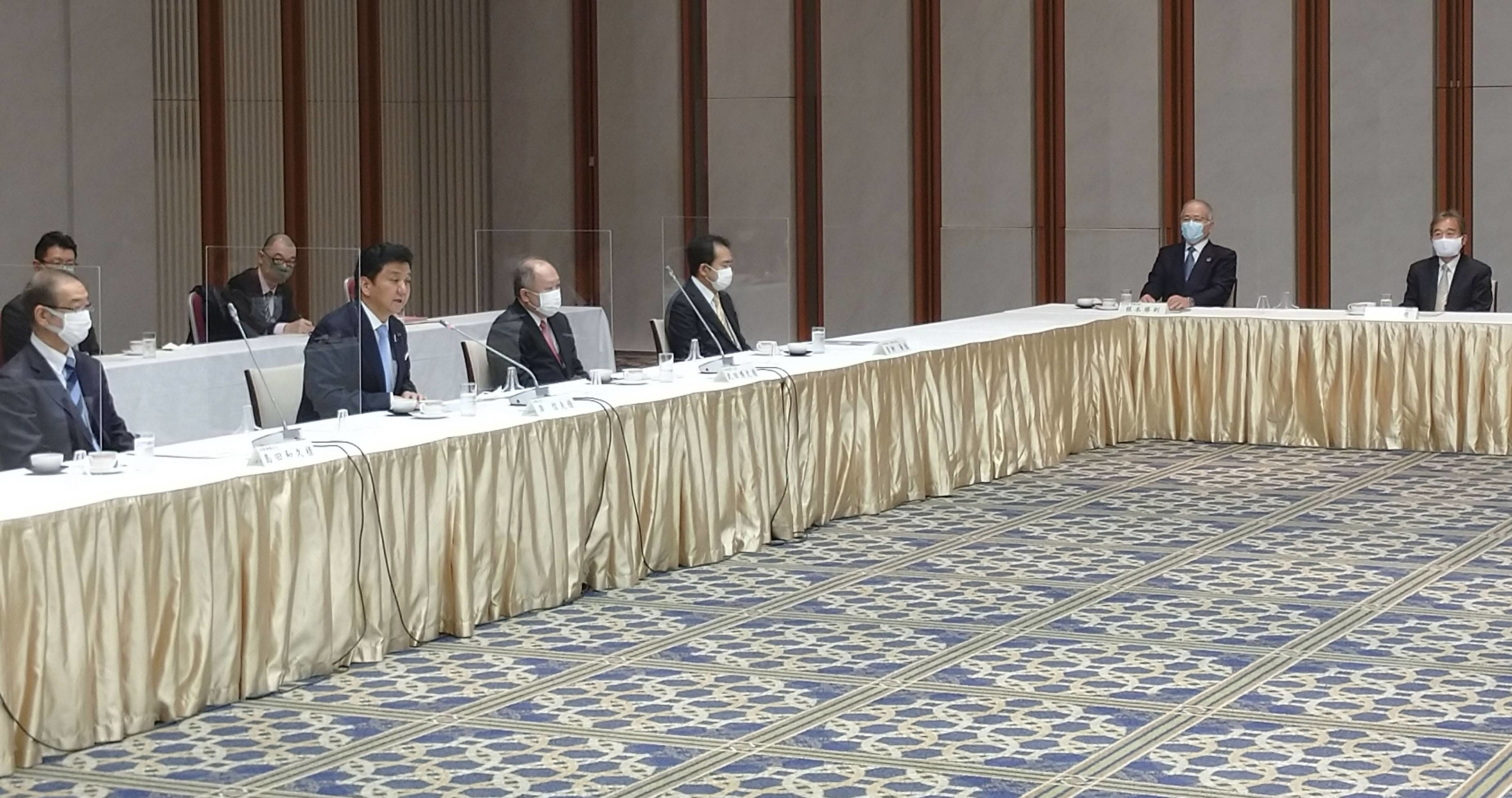 Defense Minister Nobuo Kishi (second from left, front) speaks at a meeting with executives of the Japan Business Federation in Tokyo on Thursday. | KYODO