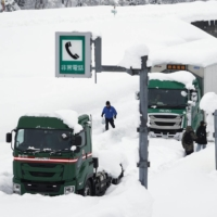 Trapped on a snowy Japan expressway, man witnesses daughter's birth via smartphone