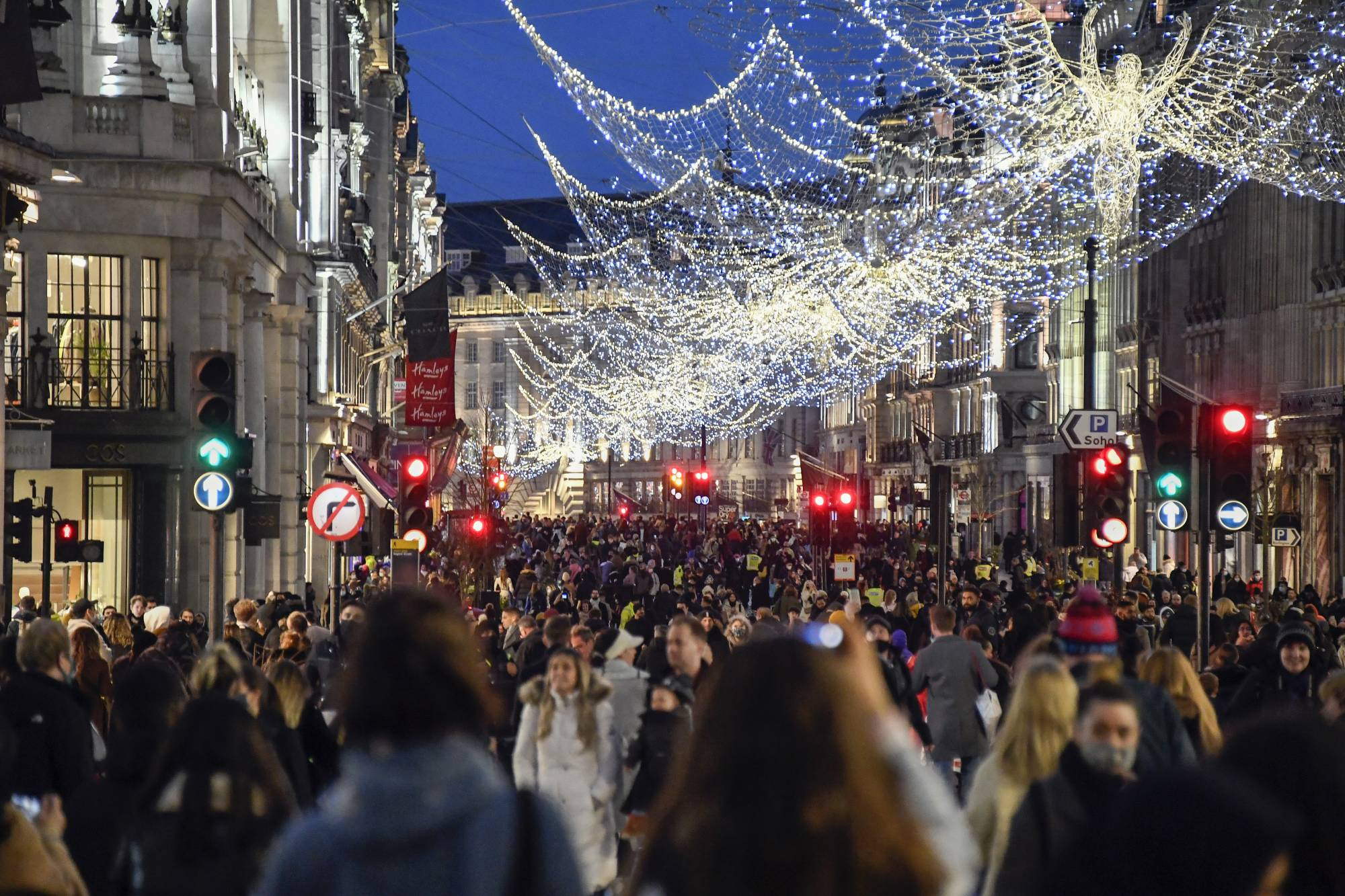 Shoppers crowd Regent Street in London on Saturday ahead of the new Tier 4 restriction measures. | AP