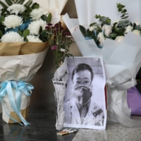 A makeshift memorial for Li Wenliang at the Central Hospital of Wuhan  | REUTERS