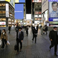 Osaka's Dotonbori district on Dec. 14. On Sunday, Osaka Prefecture recorded 251 new COVID-19 infections, ending a streak of five days through Saturday with over 300 new cases. | KYODO
