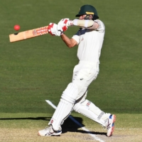 Australia's Joe Burns hits a six to give Australia the victory on the third day of their first test match against India on Saturday in Adelaide, Australia. | AFP-JIJI