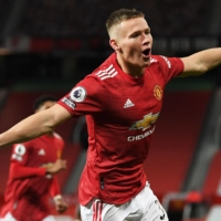 Manchester United midfielder Scott McTominay celebrates after scoring against Leeds during their match in Manchester, England, on Sunday. | AFP-JIJI
