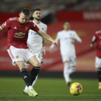 Manchester United's Scott McTominay shoots to score his side's opening goal during a Premier League match against Leeds on Sunday at Old Trafford. | AP