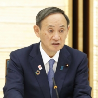Prime Minister Yoshihide Suga says the government must beat the coronavirus in order to win back public support. | KYODO