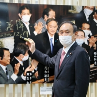 Denying need for Japan emergency, Suga clashes with medical groups