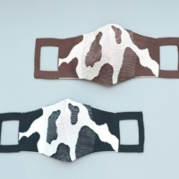 Protective spots: KNT365's eco-friendly Holstein Friesian cow print masks are made of cotton and recycled polyester and seamlessly knitted to avoid any waste offcuts. |