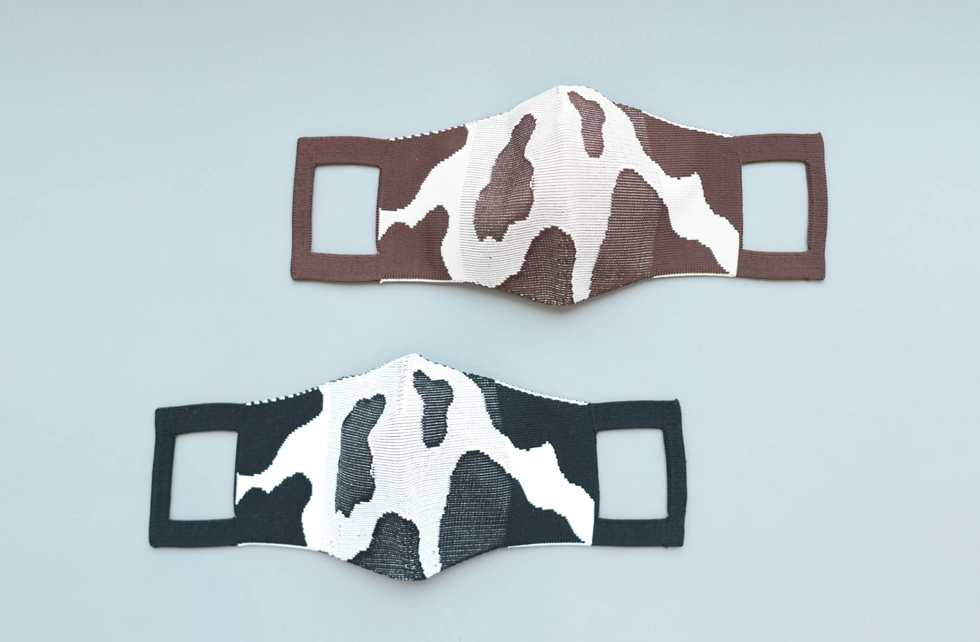 Protective spots: KNT365's eco-friendly Holstein Friesian cow print masks are made of cotton and recycled polyester and seamlessly knitted to avoid any waste offcuts.