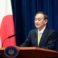 Prime Minster Yoshihide Suga speaks during a news conference in Tokyo on Dec. 4. | REUTERS