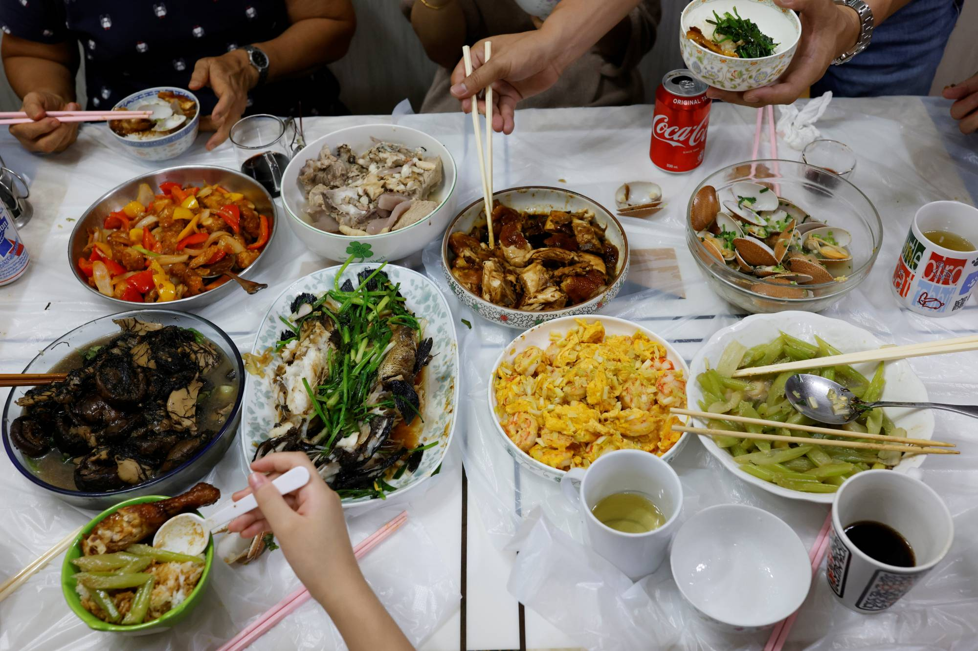 The Lai family has dinner at Asa Lai's parent's home in Hong Kong. | REUTERS