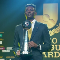 Reysol striker Michael Olunga receives the league's Most Valuable Player trophy during the 2020 J. League Awards on Tuesday. | COURTESY OF THE J. LEAGUE
