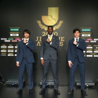 Frontale midfielder Kaoru Mitoma (left), defender Shogo Taniguchi (right) and Reysol striker Michael Olunga pose for photos following Tuesday's J. League Awards. | COURTESY OF THE J. LEAGUE