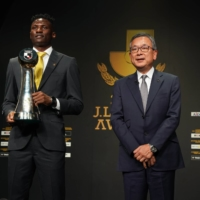 League MVP Michael Olunga poses with league chairman Mitsuru Murai during Tuesday's ceremony. | COURTESY OF THE J. LEAGUE