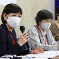 Sachiko Ishizuka (left), who was born as a result of reproductive treatment using donor sperm, speaks at a news conference in November in Tokyo. | KYODO