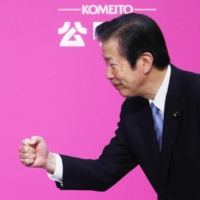 Prime Minister Yoshihide Suga (left) and Komeito Chief Representative Natsuo Yamaguchi exchange a fist bump at a Komeito convention in Tokyo on Sept. 27. Yamaguchi was reappointed to serve his seventh term as party chief the same day. | KYODO