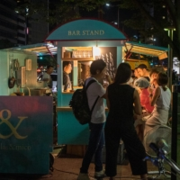 Outdoor eats: Diners crowd around Telas&Mico, a yatai (street stall) in Fukuoka. | OSCAR BOYD