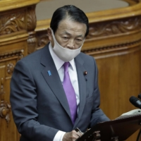 Taro Aso, deputy prime minister and finance minister, speaks during a plenary session at the Upper House in Tokyo on Nov. 30. | BLOOMBERG