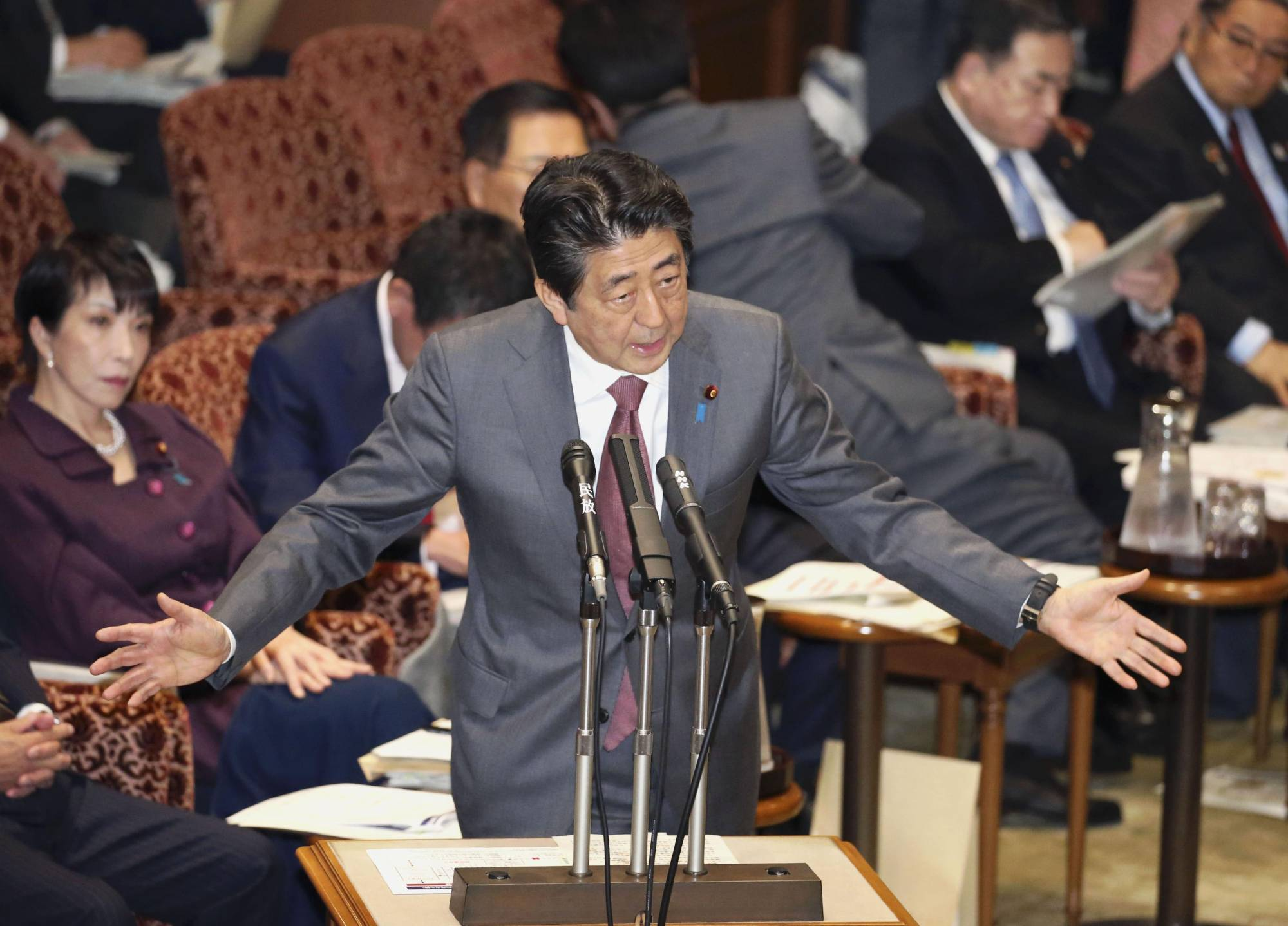Prime Minister Shinzo Abe answers questions in the Diet in March. | KYODO