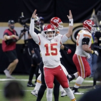 Chiefs quarterback Patrick Mahomes reacts after throwing a touchdown against the Saints during the first half of their game in New Orleans on Sunday.   AP