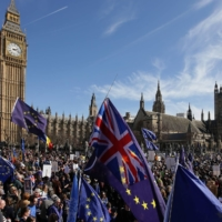 Demonstrators gather in front of the Houses of Parliament in London following an anti-Brexit, pro-European Union march in March 2017.  | AFP-JIJI