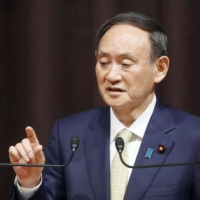 Prime Minister Yoshihide Suga speaks at a hotel in Tokyo on Thursday. | KYODO