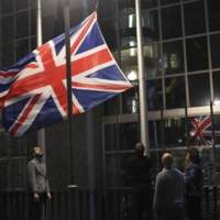 The U.K. flag is lowered and removed from outside of the European Parliament in Brussels on Jan. 31.  | AP