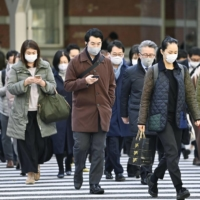A crossing near Tokyo Station on Friday | KYODO