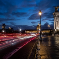 Trails of light left by cars amid heavy traffic on the Alexandre III bridge in Paris on Thursday. France has confirmed the first case of a new coronavirus variant that recently emerged in Britain, its Health Ministry said. | AFP-JIJI