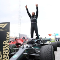 Lewis Hamilton celebrates after clinching the Formula One title in Istanbul on Nov. 15. | REUTERS