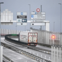 Trucks depart for England via the Channel Tunnel at the port of Calais on Friday.  | AFP-JIJI