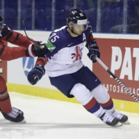 Canada's Mark Stone (left) challenge's Great Britain's Robert Dowd during the Ice Hockey World Championships in Kosice, Slovakia, on May 12, 2019. | AP