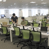 Most seats are empty at the headquarters of Calbee Inc. in Tokyo in August as many employees work from home. | KYODO