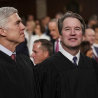 U.S. Supreme Court Justices Neil Gorsuch (left) and Brett Kavanaugh watch as President Donald Trump arrives to give his State of the Union address to a joint session on Congress at the Capitol in Washington on Feb. 5, 2019.    THE NEW YORK TIMES / POOL / VIA AP