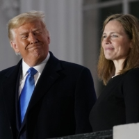 U.S. President Donald Trump and Amy Coney Barrett stand on the Blue Room Balcony after Supreme Court Justice Clarence Thomas administered the Constitutional Oath to her on the South Lawn of the White House in Washington on Oct. 26.    AP