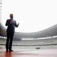 World Athletics President Sebastian Coe speaks to media outlets during his inspection of Tokyo's National Stadium on Oct. 8. | REUTERS