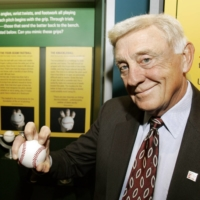 Phil Niekro displays a knuckleball grip at the Great Lakes Science Center in Cleveland on March 29, 2007. | AP