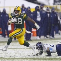 Packers running back A.J. Dillon rushes for a touchdown against the Titans in Green Bay, Wisconsin, on Sunday.   USA TODAY / VIA REUTERS