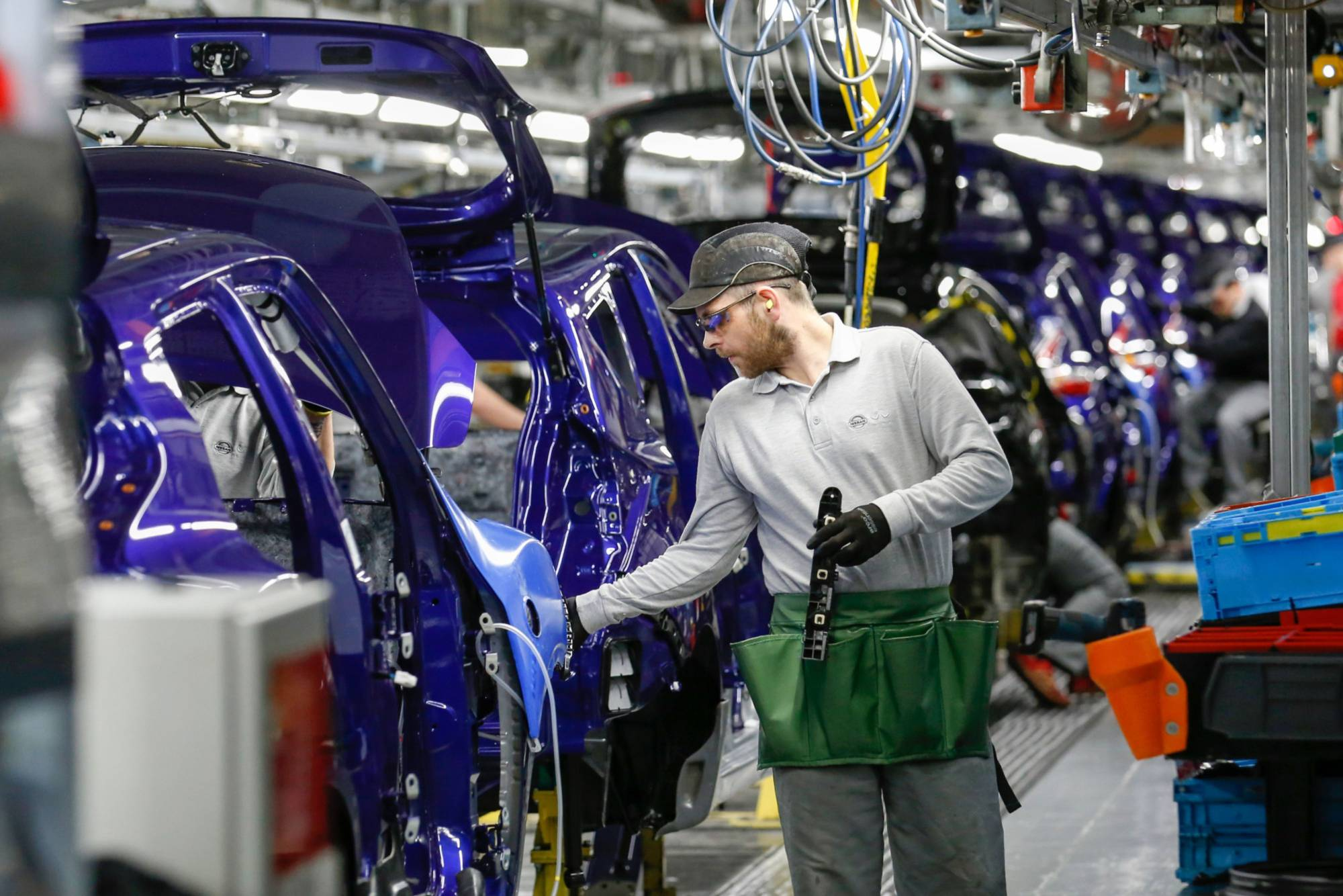 The production line at the Nissan Motor Co. plant in Sunderland, England. The company recently decided against making an electric model at the factory in northeast England and almost two years ago scrapped plans to build another sport utility vehicle at the same site. | BLOOMBERG