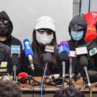 Family members of a group of Hong Kong democracy activists who are facing trial in mainland China hold a news conference in Hong Kong on Monday.   | AFP-JIJI