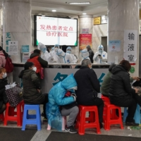 People wait to be treated at Wuhan Red Cross Hospital in January.   | AFP-JIJI