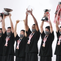 Meisei players celebrate after winning the Winter Cup final on Tuesday. | COURTESY OF THE JAPAN BASKETBALL ASSOCIATION