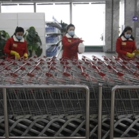Staffers at a department store in Pyongyang disinfect the store before it opens Monday. | AP