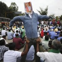 Protesting farmers hold an effigy of Indian Prime Minister Narendra Modi during a demonstration in Bangalore, India, on Dec. 9.  | AP