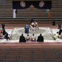 The Spring Grand Sumo Tournament was held behind closed doors in Osaka in March. | KYODO