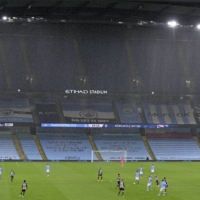 Rains falls on Etihad Stadium during a match between Manchester City and Newcastle in Manchester, England, on Dec. 26. | POOL / VIA AP