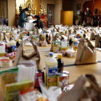 Helping out: Volunteers at a Buddhist temple organize care packages for Vietnamese people living in Japan during the state of emergency in April. | KYODO