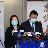 Hong Kong's acting chief superintendent of the Commercial Crime Bureau, Cheng Lai-ki (left), speaks to the media in Hong Kong on Wednesday. | AFP-JIJI